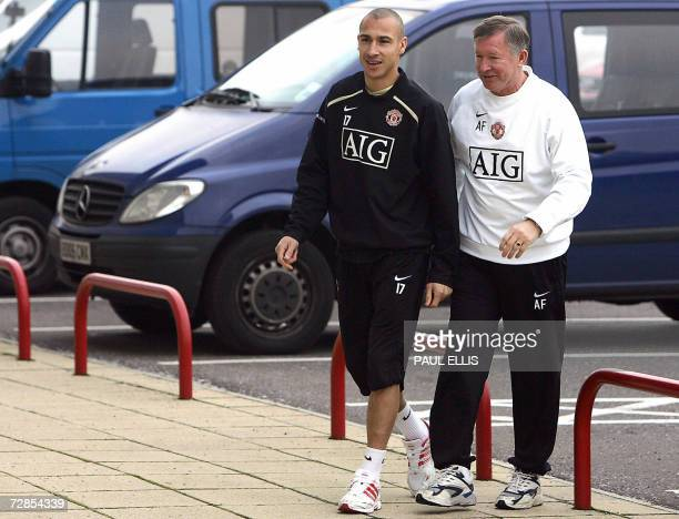 Swedish footballer Henrik Larsson arrives for a press conference with Manchester United manager Alex Ferguson at the Carrington training ground in...