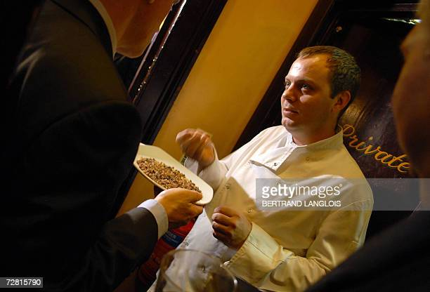 The chef of the Star Tavern tries to identify a plate of myrrh during a challenge organised by members of the British Royal Society of Chemistry in a...