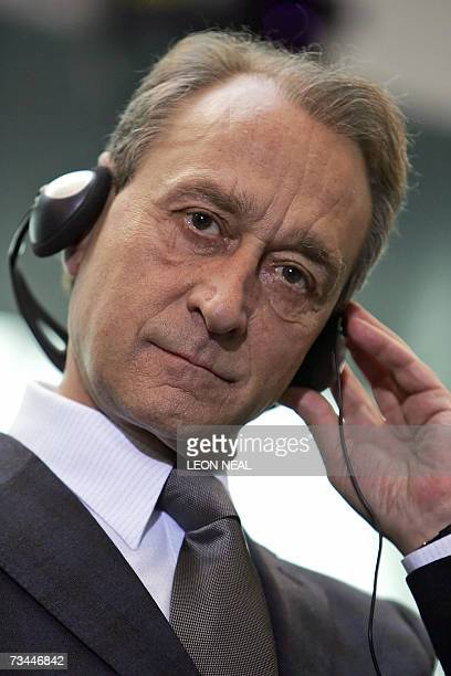 The Mayor of Paris Bertrand Delanoe adjusts his headphones during a press conference with the Mayor of London Ken Livingstone the Mayor of Beijing...