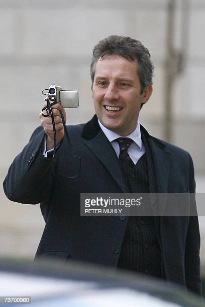 United Kingdom: The son of the leader of the Democratic Unionist Party Ian Paisley, Ian Paisley Jr., videos the press as as he arrives at Stormont in...