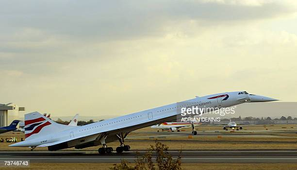 This picture taken 24 October 2003 shows Concorde touching down at London's Heathrow airport after the last scheduled flight from New York A model...