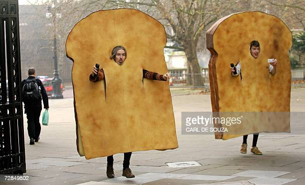 Two actors dressed as slices of toast run down a street during the making of a film in central London 19 December 2006 AFP PHOTO/CARL DE SOUZA