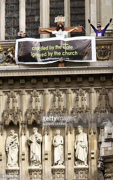 United Kingdom: Two protesters of a radical fathers' rights group demonstrate on London's Westminster Abbey, 13 April 2006. The pair were carrying a...