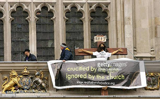 United Kingdom: Two protesters of a radical fathers' rights group scale London's Westminster Abbey, 13 April 2006. The pair were carrying a dummy on...