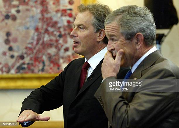 US President George W Bush gestures during a joint press conference with British Prime Minister Tony Blair at the Gleneagles hotel 07 July 2005 for...