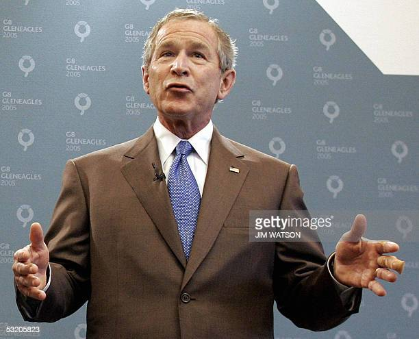 US President George W Bush gestures with his left hand bandaged during a joint press conference with British Prime Minister Tony Blair at the...