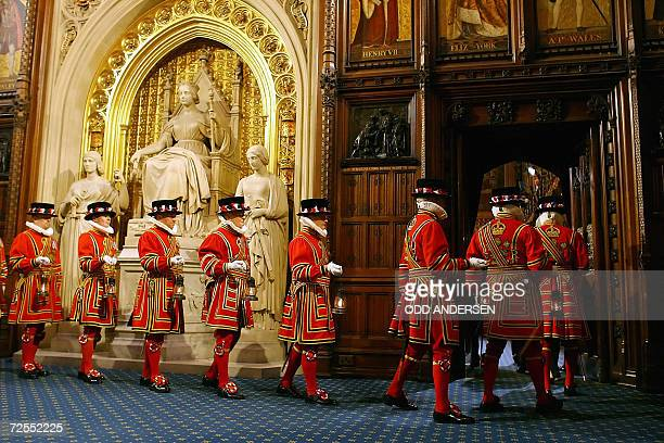 Yeoman Warders or Beefeaters prepare for the 'Ceremonial Search' in the Prince's Chamber in the House of Lords as Britain's Queen Elizabeth II...