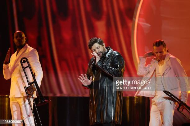 United Kingdom's James Newman performs during the final of the 65th edition of the Eurovision Song Contest 2021, at the Ahoy convention centre in...