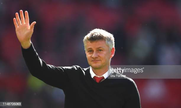 United manager Ole Gunnar Solskjaer waves to the crowd after the Premier League match between Manchester United and Cardiff City at Old Trafford on...