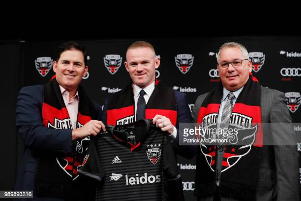DC United Managing Partner and CEO Jason Levien Wayne Rooney of DC United and DC United General Manager Dave Kasper pose with a jersey during his...