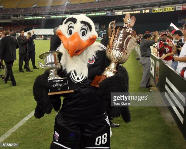 United mascot Talon holds the 1998 CONCACAF Champions Cup and the Inter-Continental Cup during half time ceremony honoring the 1998 team during an...
