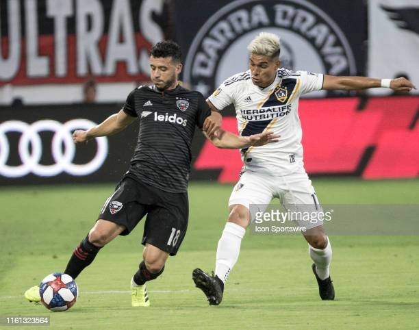 C United midfielder Felipe Martins holds off Los Angeles Galaxy forward Favio Alvarez during a MLS match between DC United and the LAGalaxy on August...