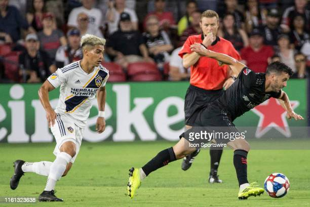C United midfielder Felipe Martins scurries away from Los Angeles Galaxy forward Favio Alvarez during a MLS match between DC United and the LAGalaxy...
