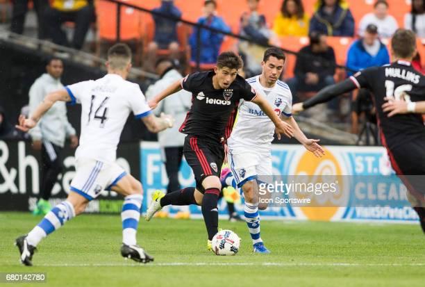 C United midfielder Ian Harkes moves between Montreal Impact midfielder Adrian Arregui and Montreal defender Daniel Lovitz during a MLS game between...
