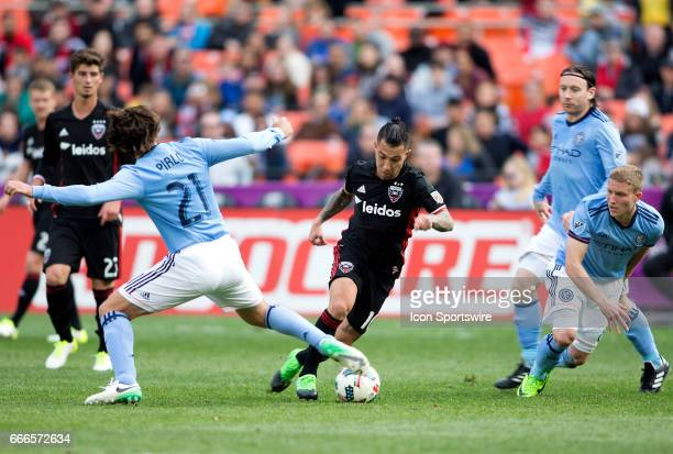 C United midfielder Luciano Acosta dribbles away from New York City FC midfielder Andrea Pirlo during a MLS game between DC United and New York City...