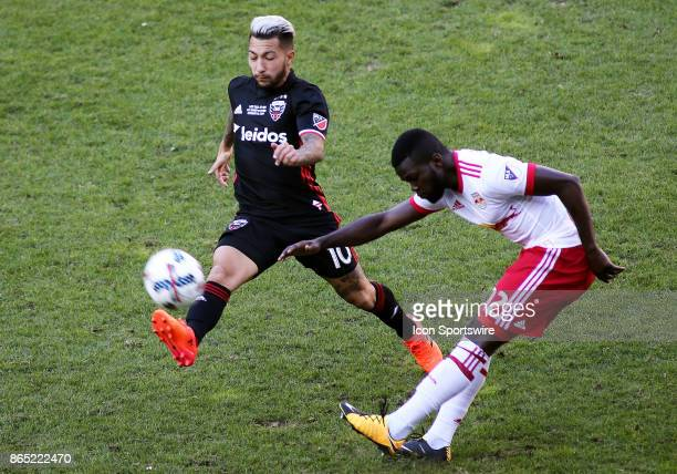 C United midfielder Luciano Acosta in action against New York Red Bulls defender Kemar Lawrence during a match between DC United and the New York Red...