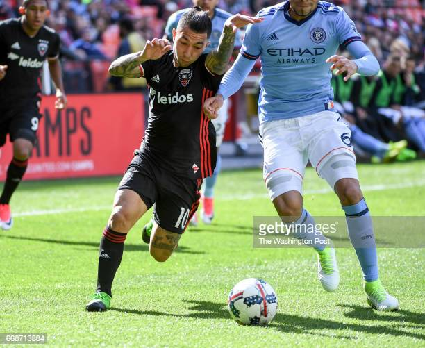 C United midfielder Luciano Acosta rushes for the ball against New York City FC defender Alexander Callens at RFK Stadium in Washington DC on April 8...