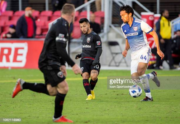C United midfielder Luciano Acosta slots a pass away from FC Dallas defender Abel Aguilar during a MLS match between DC United and FC Dallas on...