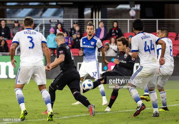 C United midfielder Nick DeLeon shoots past FC Dallas defender Abel Aguilar during a MLS match between DC United and FC Dallas on October 13 at Audi...