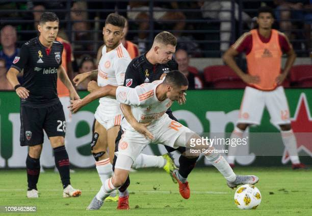 C United midfielder Russell Canouse blocks Atlanta United midfielder Miguel Almiron during a MLS match between DC United and Atlanta United FC on...