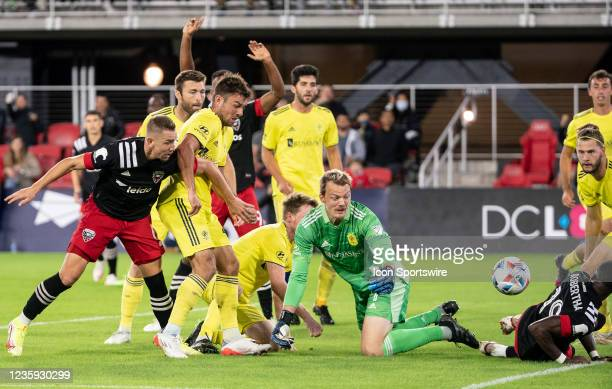 United midfielder Russell Canouse gets a shot past Nashville SC goalkeeper Joe Willis during an MLS match between D.C. United and Nashville SC on...