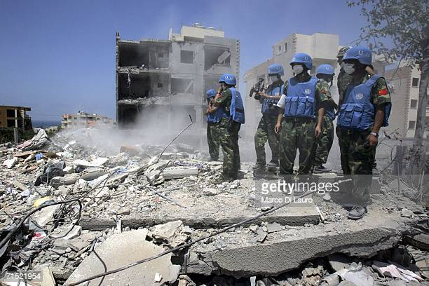 United Nation Interim Force in Lebanon rescue teams excavate a bomb site during a UN mission to recover bodies from the site where a UNIFIL solider...