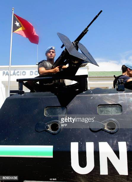 United Nation peacekeeping force soldiers secure a government building where militant leader Gastao Salsinha surrendered during a ceremony in Dili on...