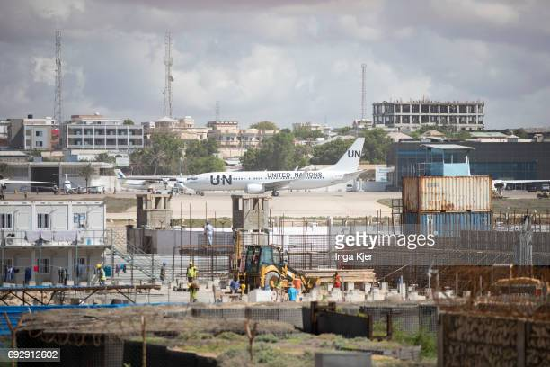 A United Nations aircraft at the airport of Mogadishu In the foreground is a construction site on May 01 2017 in Mogadischu Somalia