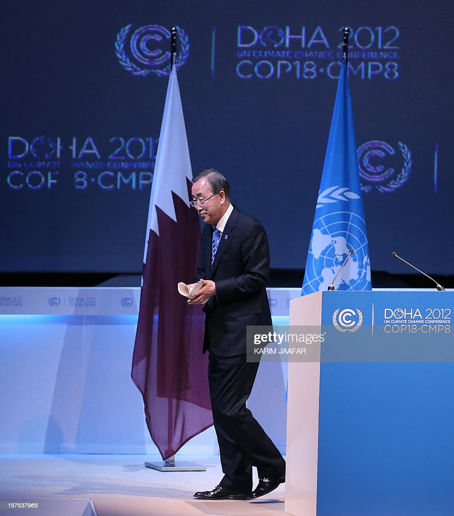 United Nations chief Ban Ki-moon leaves the stage after addressing the opening ceremony of Plenary Session of the High-Level Summit of the United Nations Framework Convention on Climate Change (UNFCCC) in the Qatari capital Doha on December 4, 2012. Ki-moon said the world was faced by a global warming 'crisis' and urged bickering negotiators at climate talks in Doha to show 'strong political commitment' and compromise.
