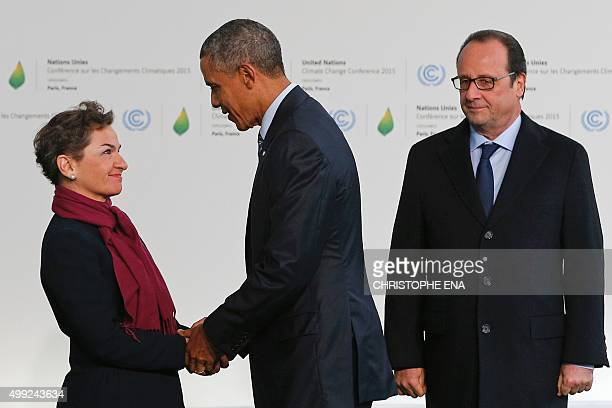 United Nations climate chief Christiana Figueres greets US President Barack Obama as French President Francois Hollande looks on during the arrivals...