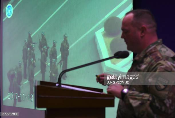 United Nations Command spokesman Colonel Chad G Carroll shows a surveillance TV footage containing the moment of defection of a North Korean Soldier...