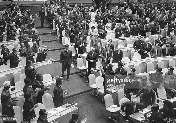 United Nations delegates applause Ahmed Ben Bella Algerian Prime Minister as he goes to the tribune to make his first speech at the United Nations...