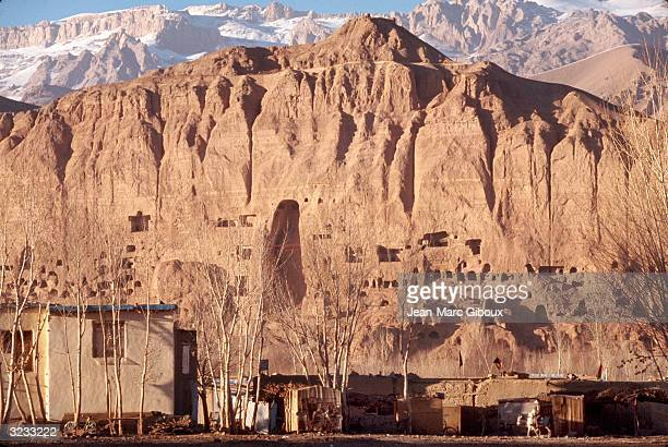 United Nations Educational Scientific and Cultural Organization work on restoring the archeological area seen November 23 2003 of Bamiyan's famed 5th...