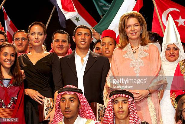United Nations goodwill ambassador actress Angelina Jolie Queen Noor widow of King Hussein and Jordanian singer Omar Abdullat pose for a picture with...