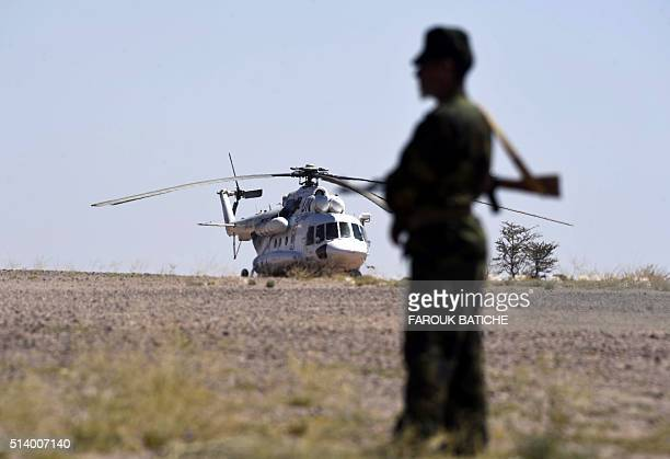 A United Nations helicopter sits on a field as a member of the Polisario Front stands guard during a visit of the UN chief on March 5 in BirLahlou in...