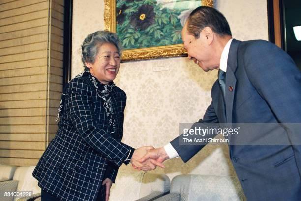 United Nations High Commissioner for Refugees Commissioner Sadako Ogata shakes hands with Japanese Prime Minister Kiichi Miyazawa at the prime...
