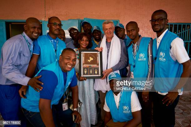 United Nations High Commissioner for refugees Filippo Grandi and UNHCR's representative in Mali Angele Djohossou receivea gift from the UN staff...