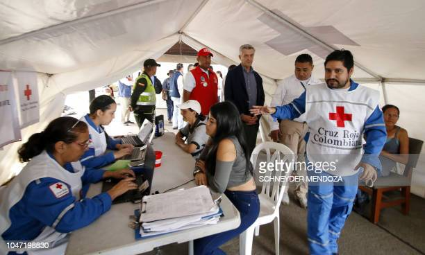 United Nations High Commissioner for Refugees Filippo Grandi speaks with Colombian Red Cross staffers during his visit to the Simon Bolivar...