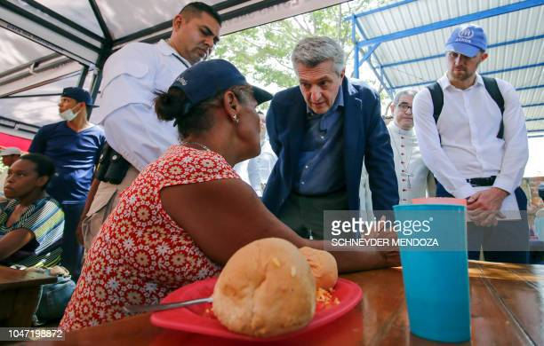 United Nations High Commissioner for Refugees Filippo Grandi speaks with a Venezuelan migrant during his visit to the Divina Providencia migrant...