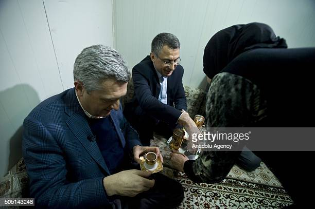 United Nations High Commissioner for Refugees Filippo Grandi visits a refugee family's prefabricated house at Turkish Prime Ministry Disaster...
