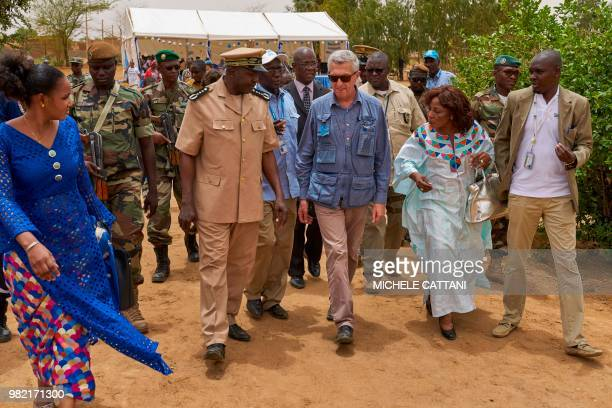 United Nations High Commissioner for refugees Filippo Grandi walks with Gao's Governor Sidiki Samake and UNHCR's representative in Mali Angele...