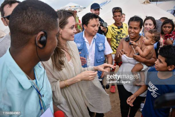 United Nations High Commissioner for Refugees Special Envoy Angelina Jolie greets refugees during her visit to a refugee camp in the border between...