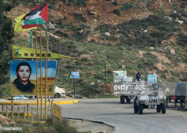 United Nations Interim Force in Lebanon armoured personnel carriers patrol along the border with Israel near the southern Lebanese village of Kfar...