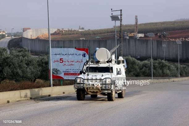 A United Nations Interim Force in Lebanon vehicle patrols along the border with Israel near the southern Lebanese village of Kfar Kila on December 9...