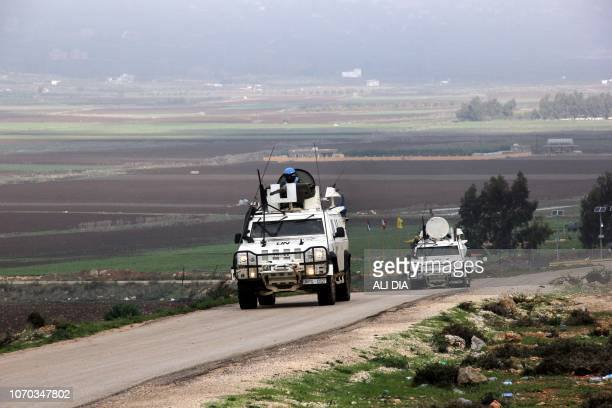 A United Nations Interim Force in Lebanon vehicle patrols along the border with Israel near the southern Lebanese city of Marjayoun with the plain of...