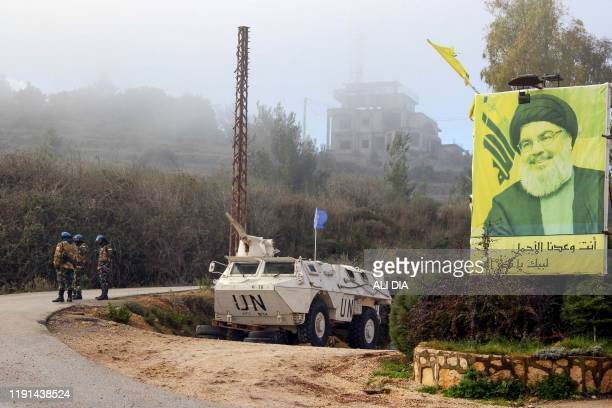 United Nations Interim Forces in Lebanon armoured vehicle is parked under a portrait of Hezbollah leader Hassan Nasrallah on a side road in the...