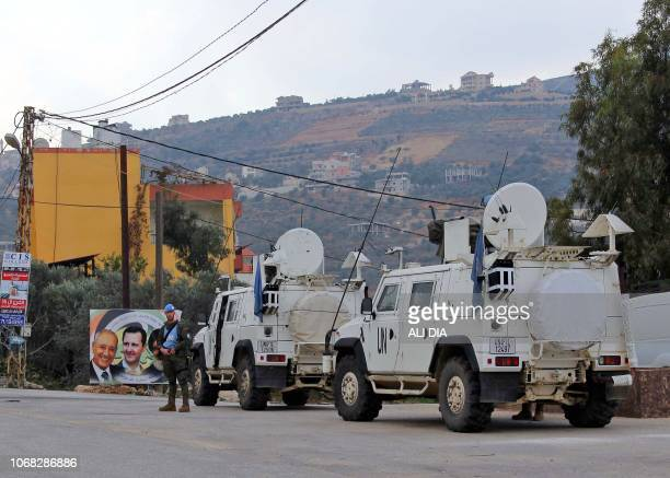 United Nations Interim Forces in Lebanon vehicles and armoured personnel carriers are seen on a road near the border between the southern Lebanese...