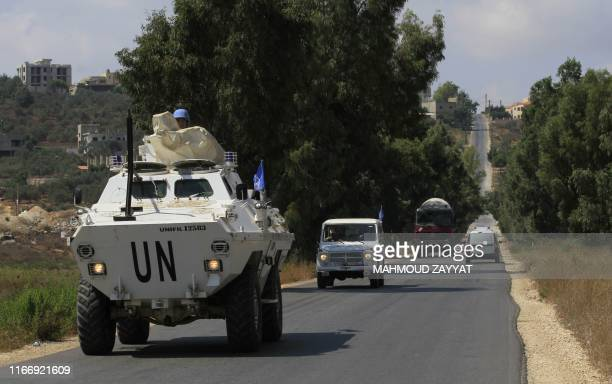 United Nations Interim Forces in Lebanon vehicles patrol along the border between Lebanon and Israel in the southern Lebanese town of Khiam on...