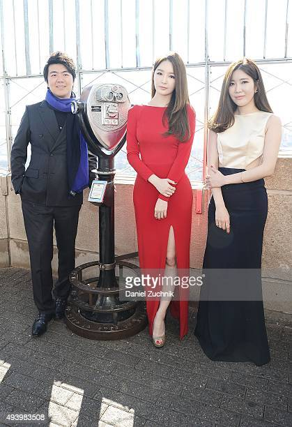 United Nations Messenger of Peace Lang Lang with Kang MinKyung and Lee HaeRi of the Kpop group Davichi attend the lighting of The Empire State...