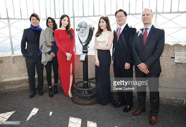 United Nations Messenger of Peace Lang Lang with Kang MinKyung and Lee HaeRi of the Kpop group Davichi with guests attend the lighting of The Empire...